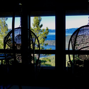 Swinging chairs inside house to look at views